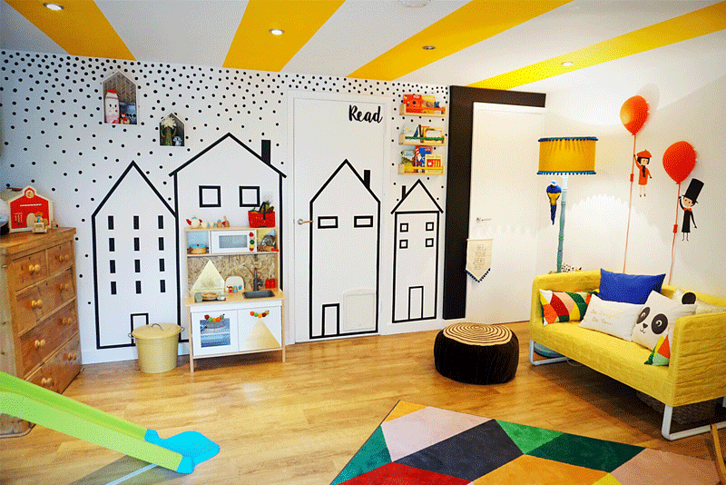 playroom with house wall decor