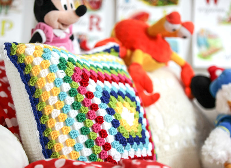 colourful retro crochet cushion
