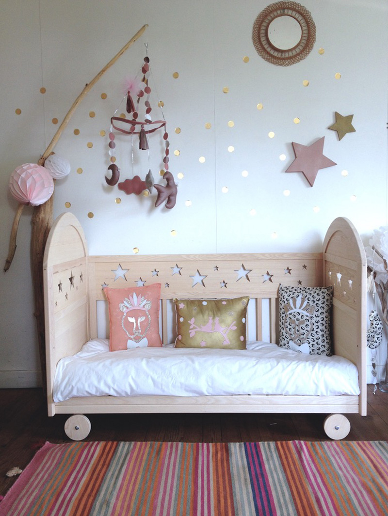 wooden cot with stars