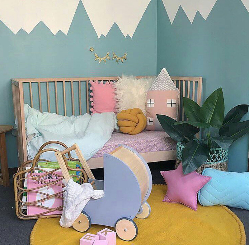girls bed with cushions