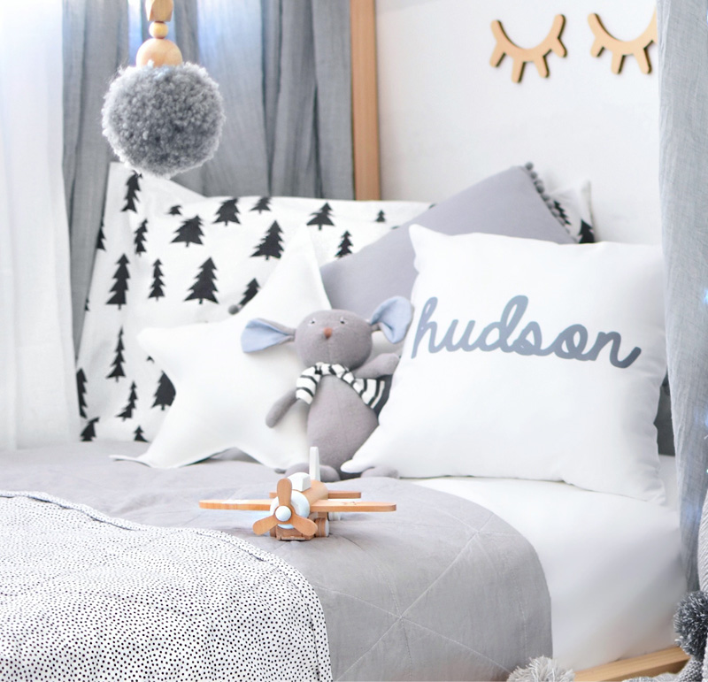 grey white cushions boys room