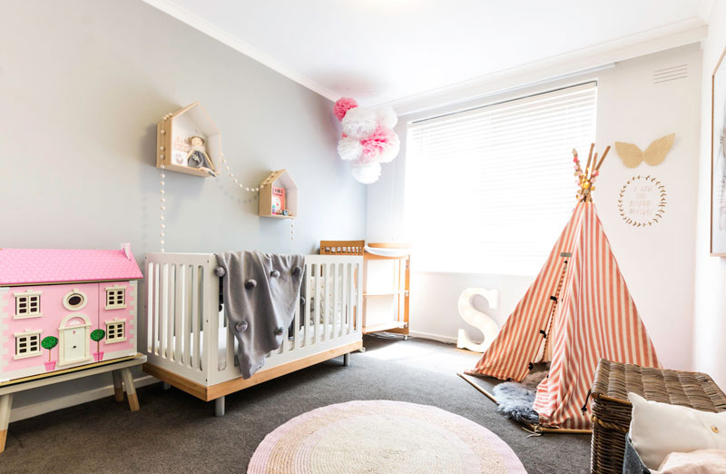 girls room with red teepee