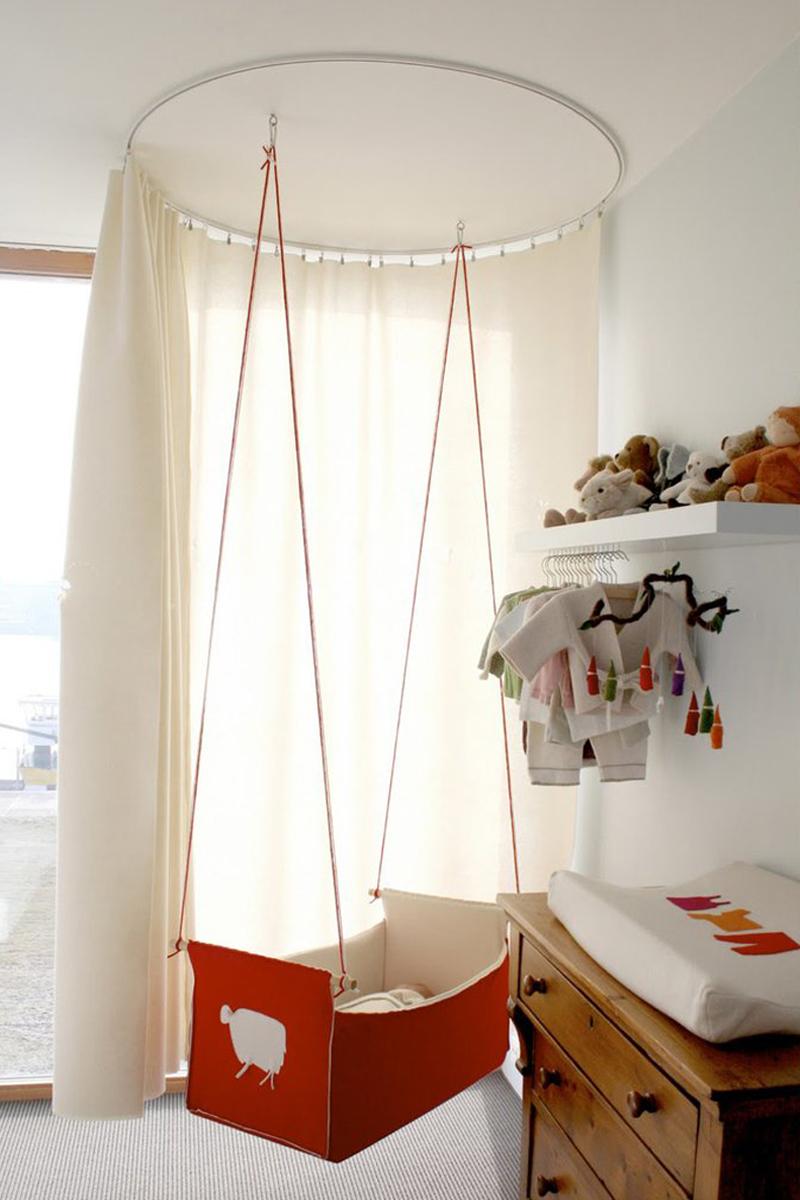 red hanging bassinet cot