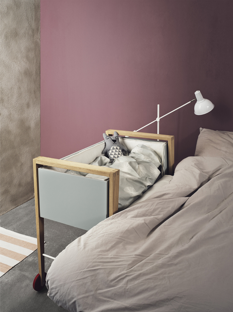 cot next to the bed