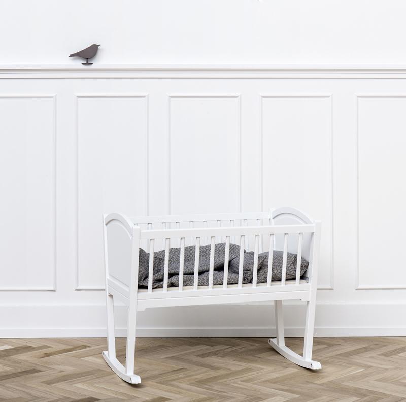 white wooden cradle
