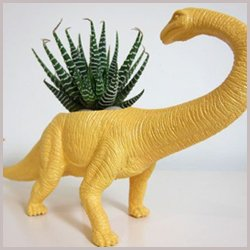 yellow dinosaur toy