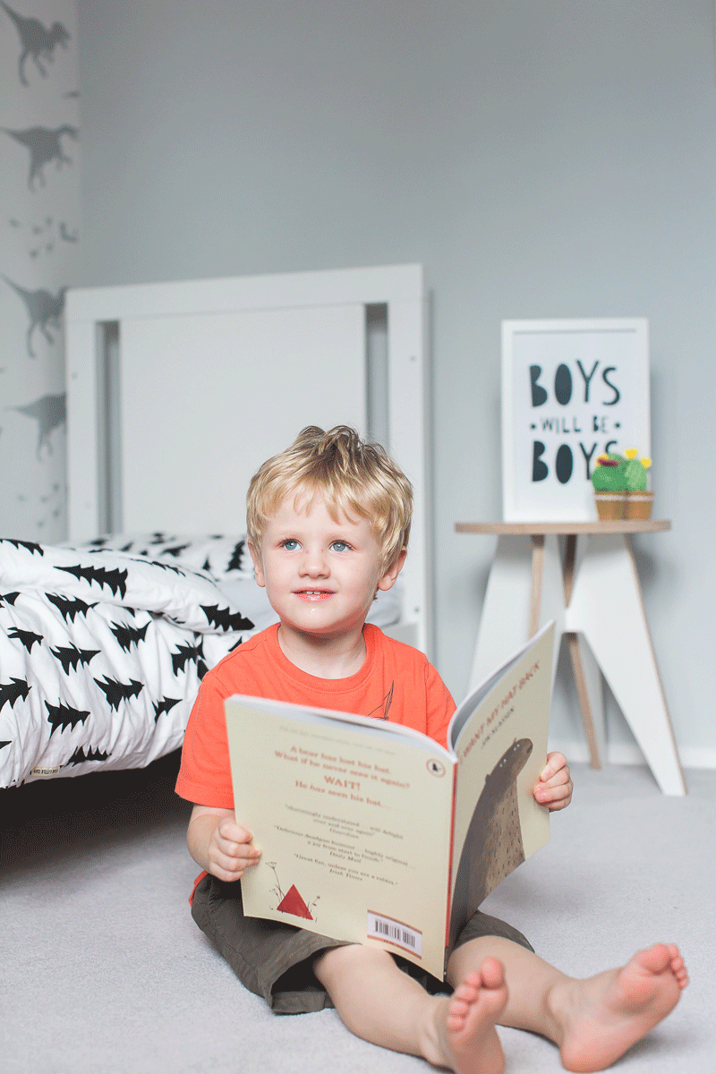 boy reading in his room