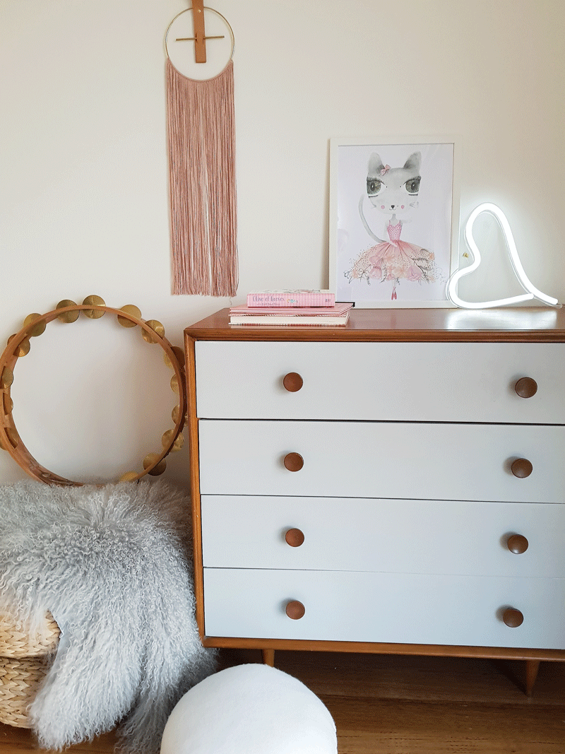 white and wood nursery dresser