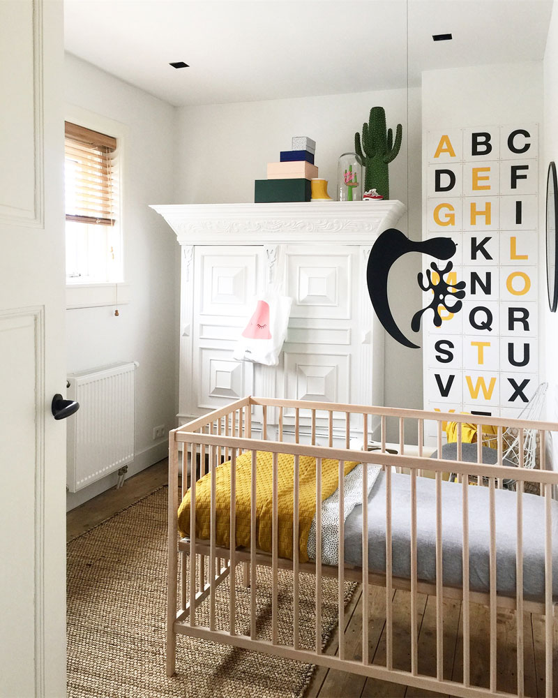 yellow black nursery room