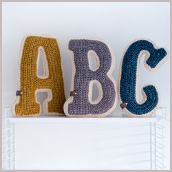 knitted letter cushions