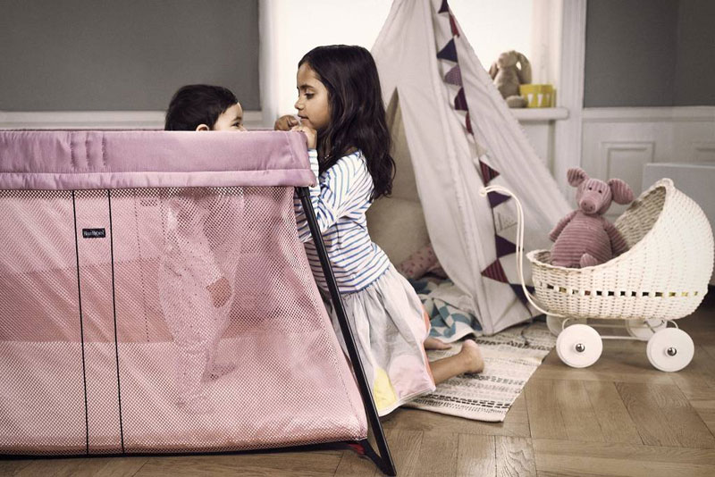 pink portable travel cot