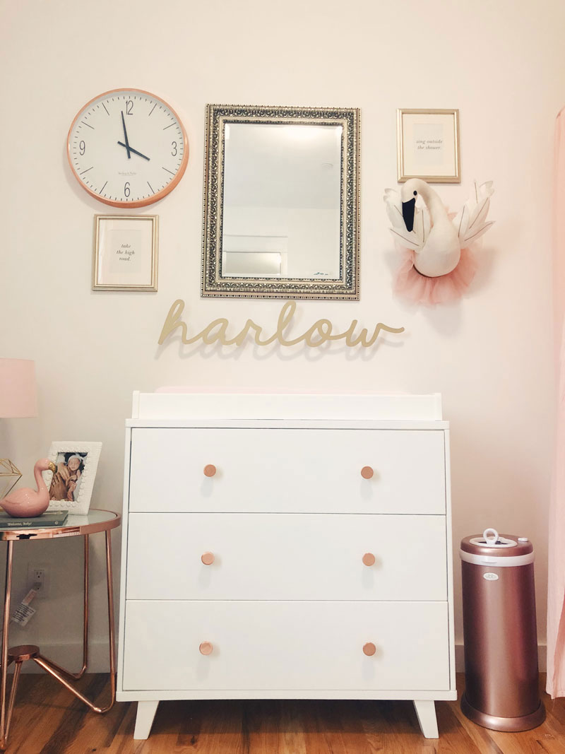 white changing table with gold knobs