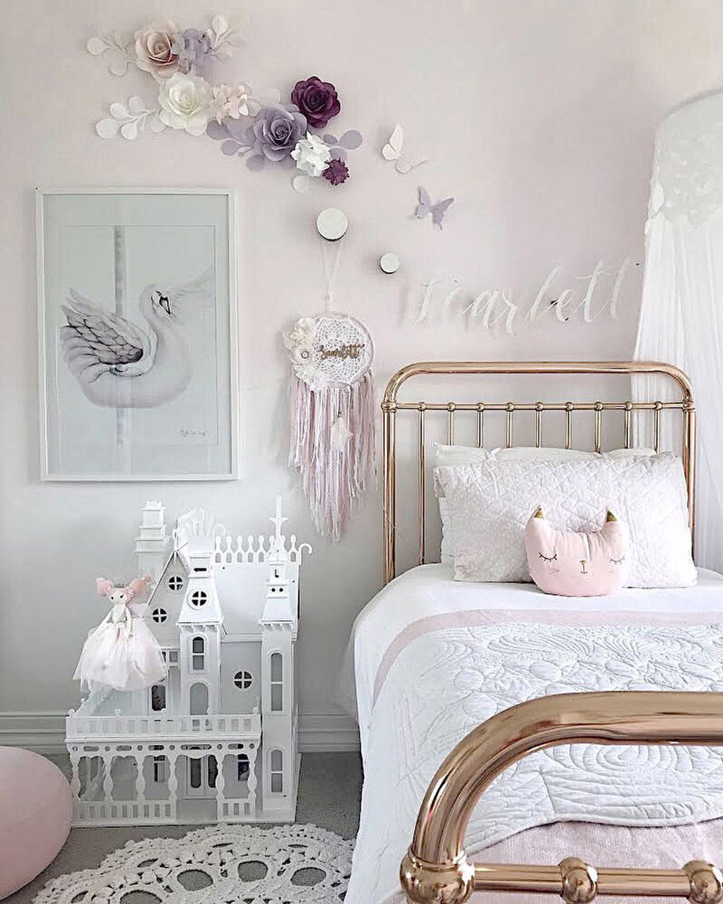 nursery room with paper rose wall decor