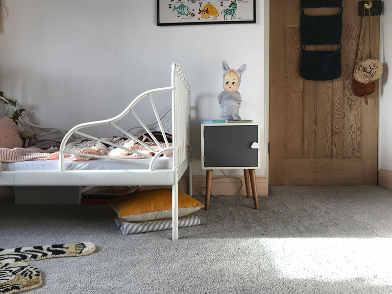 eclectic kid's room with ikea bed
