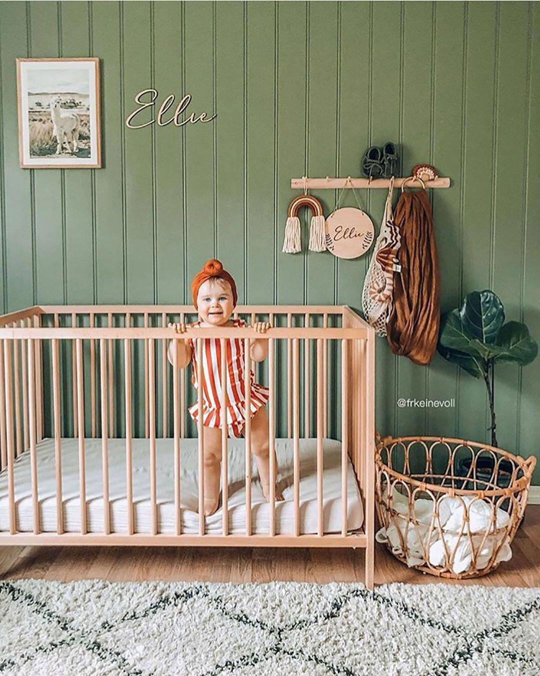 green wall baby nursery
