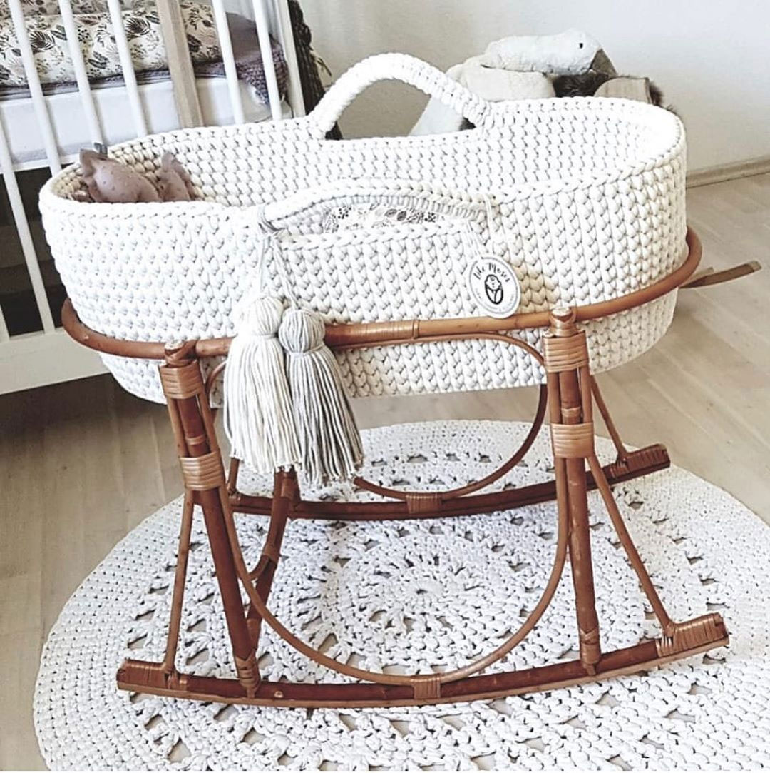 white fabric moses basket