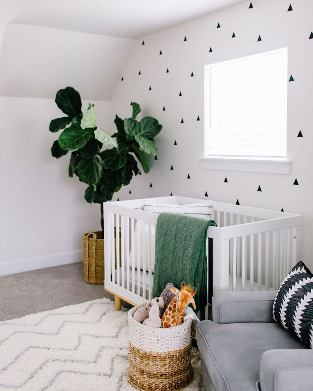green and white baby nursery room
