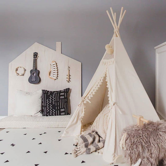 white teepee with pompoms