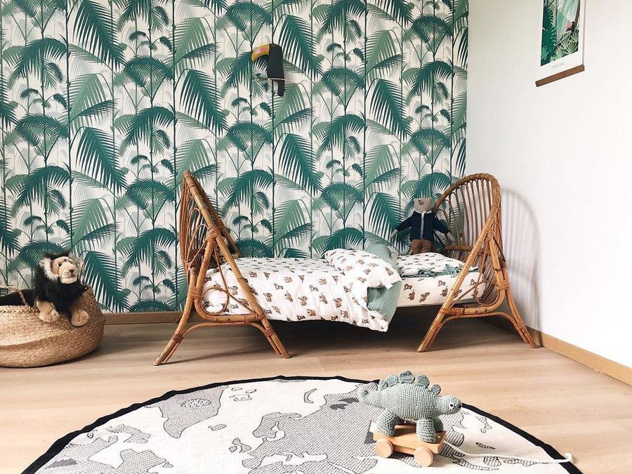 kid's room with tropical leaves wallpaper
