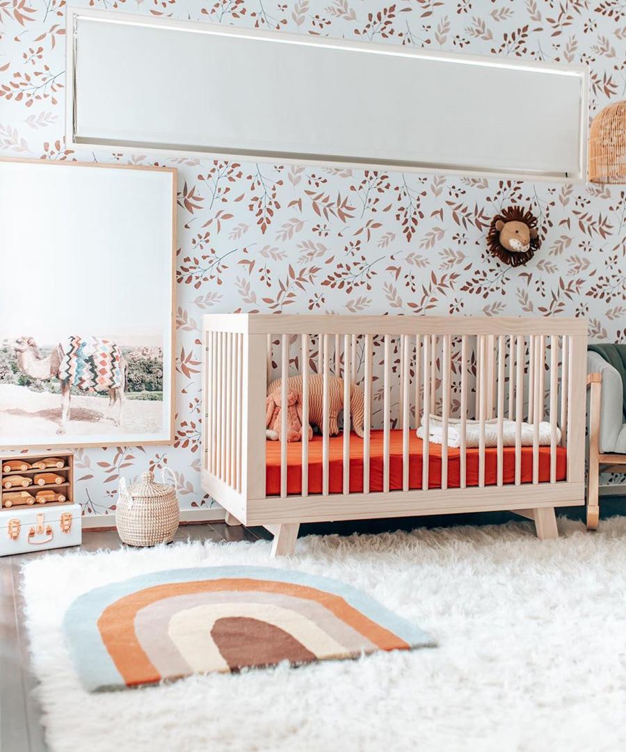 girl nursery with earthy orange