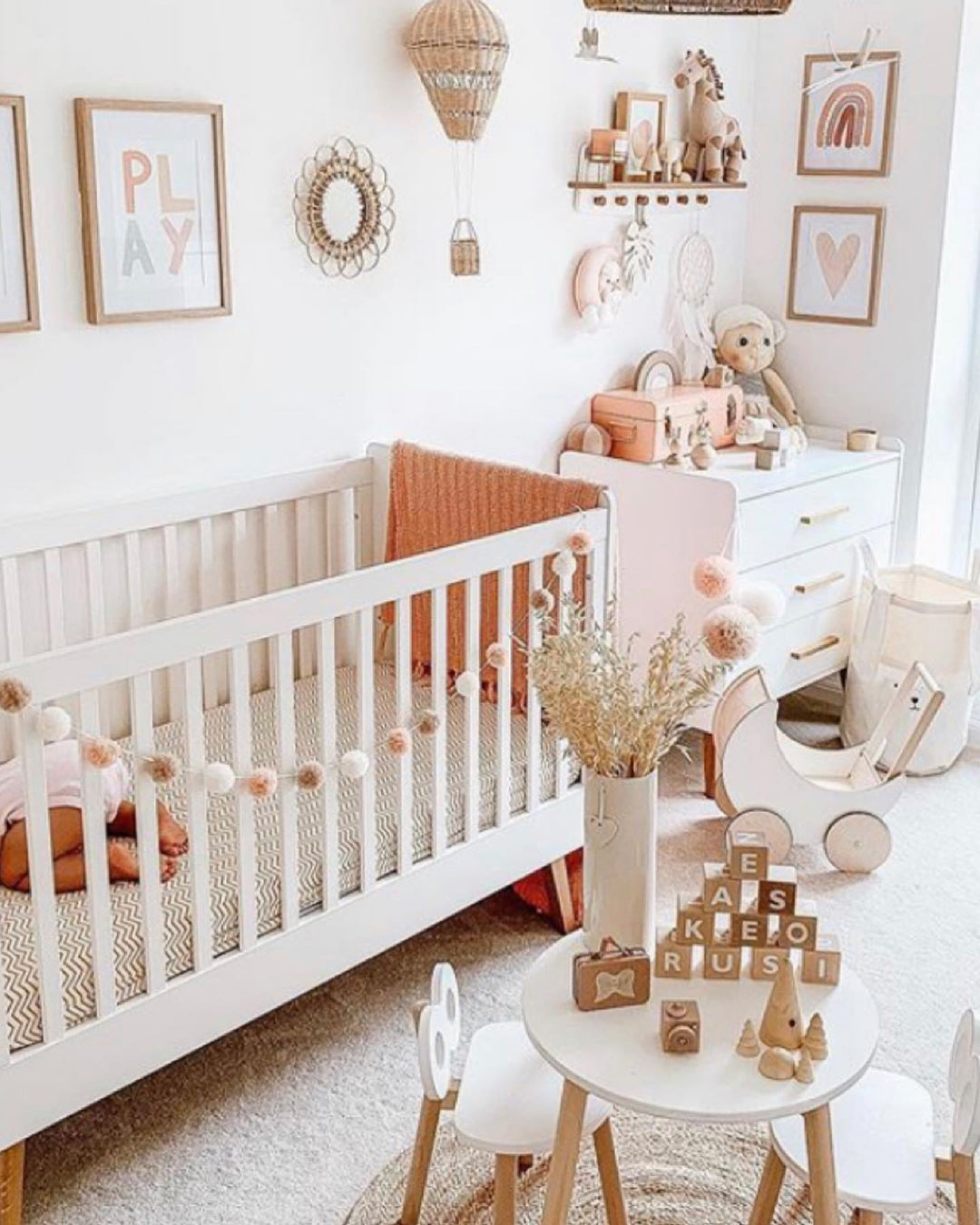 boho nursery with white
