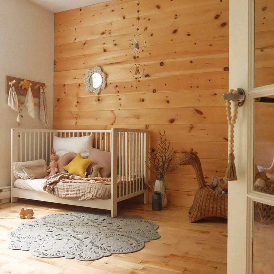 orignal baby nursery with wood wall