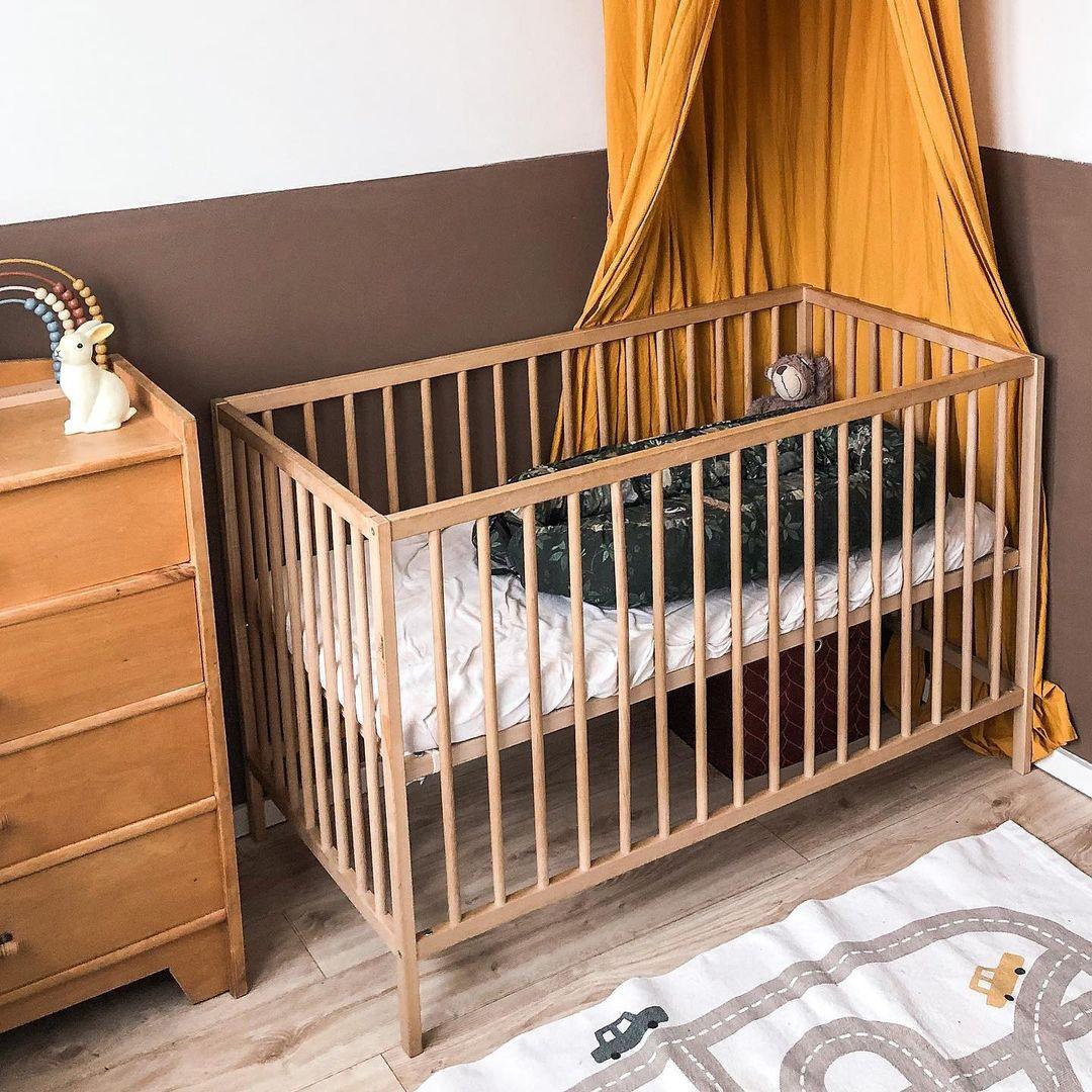 brown wall paint in baby nursery