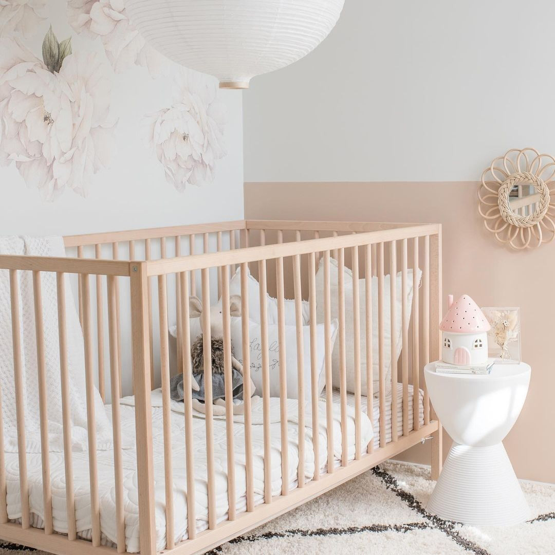 pale nude pink walls baby room